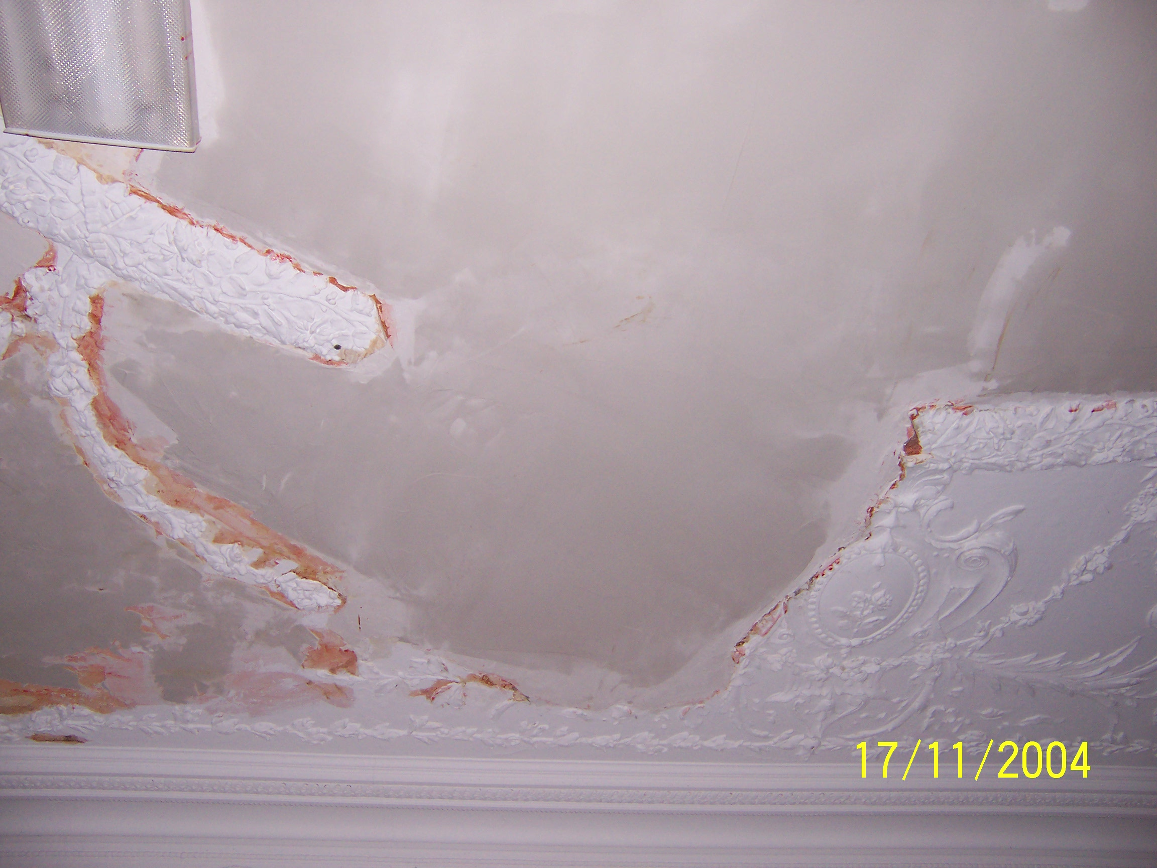 wood frame house suffered from settlement and leaks, that caused the partial collapse of an ornate Dining Room Molded Plaster Ceiling.