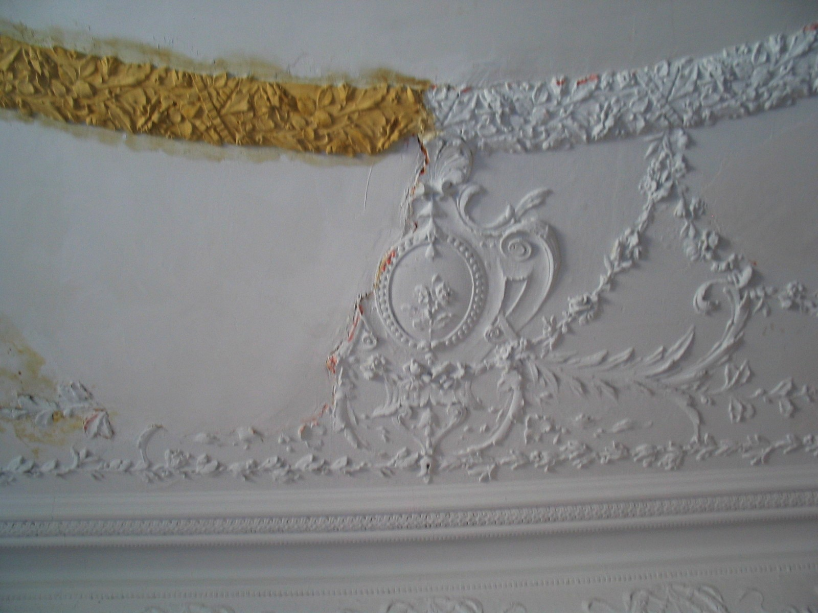 Plater Repair Silicone molds are taken of the 16' high ceilings molded plaster details where still existing, and used to recreate the missing elements.