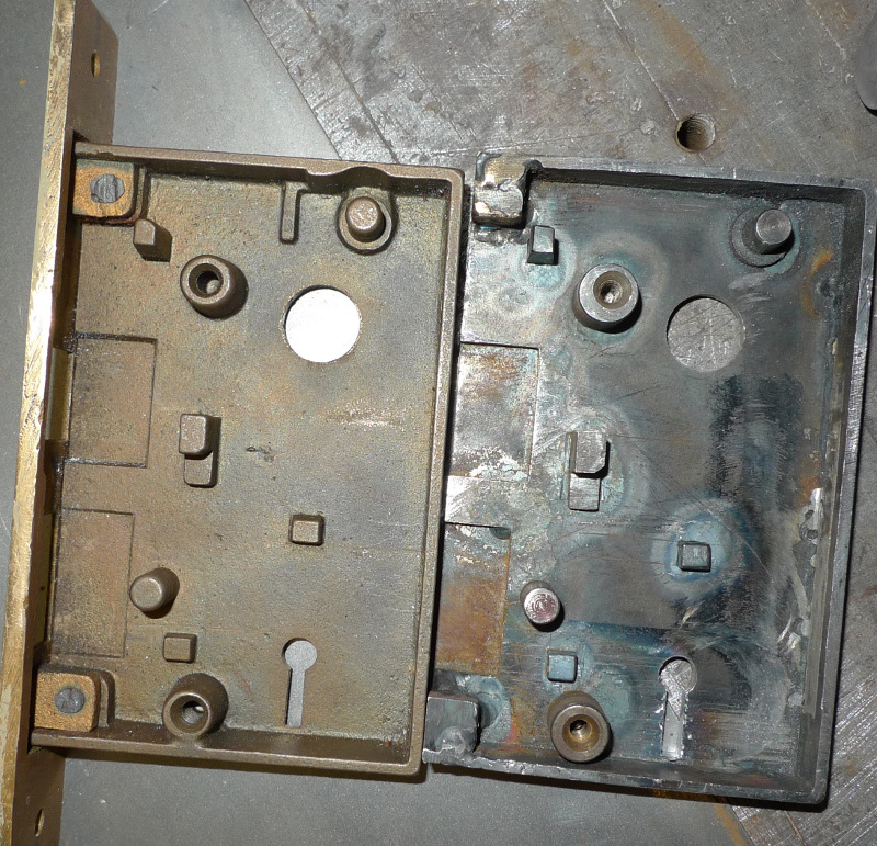 Holes welded closed, special wide backset locks machined to fit into close to original locations on door lockset housing