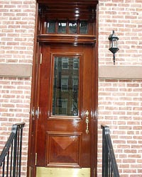 Olek fabricates custom wood doors, for landmark buildings and fine homes.